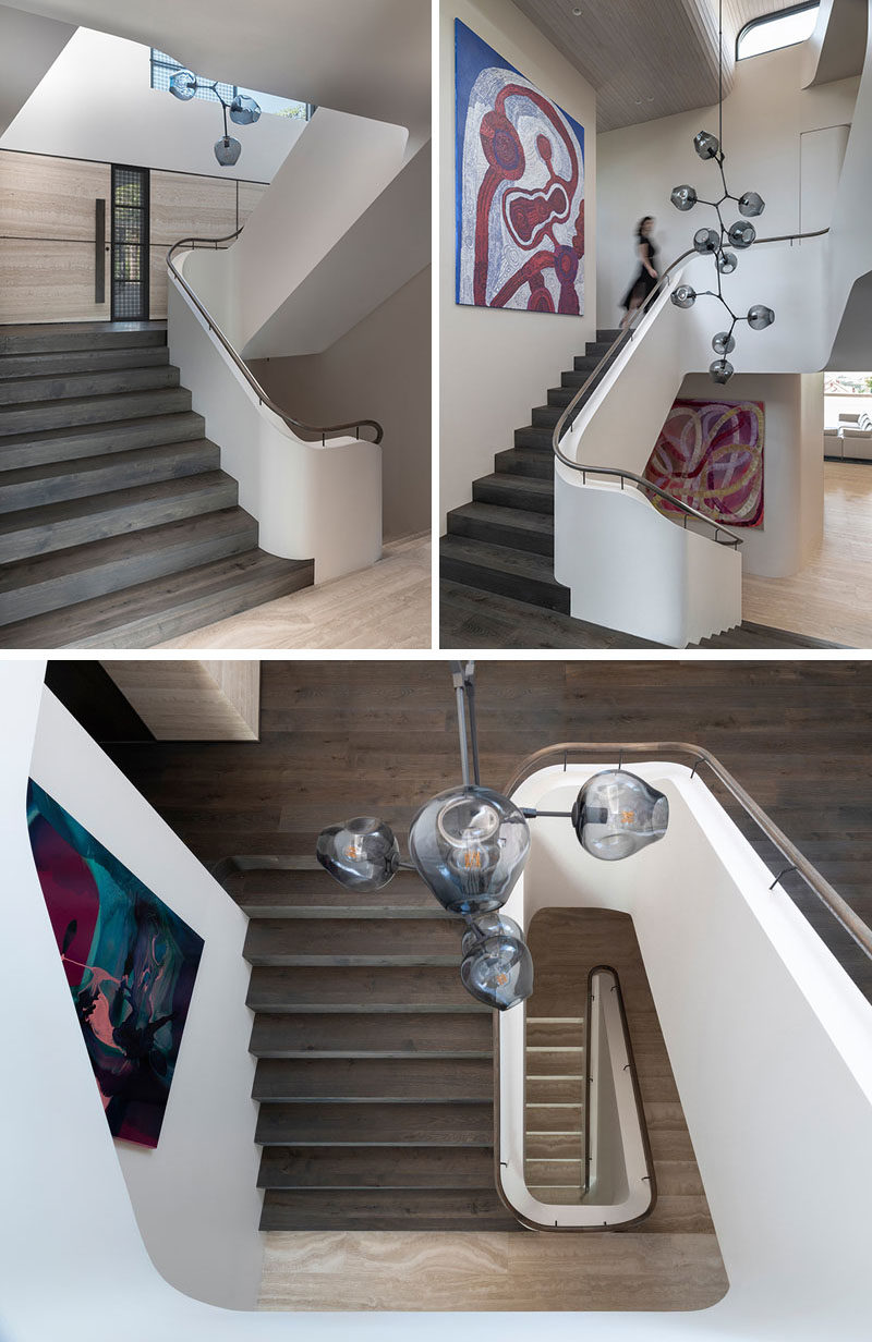 Stair Ideas - This modern staircase features a Lindsey Adelman branching bubble chandelier, while the paintings are 'Antara' by Betty Kunita Pumani and 'Sweets' by Ildiko Kovacs.  #StairIdeas #Staircase #InteriorDesign