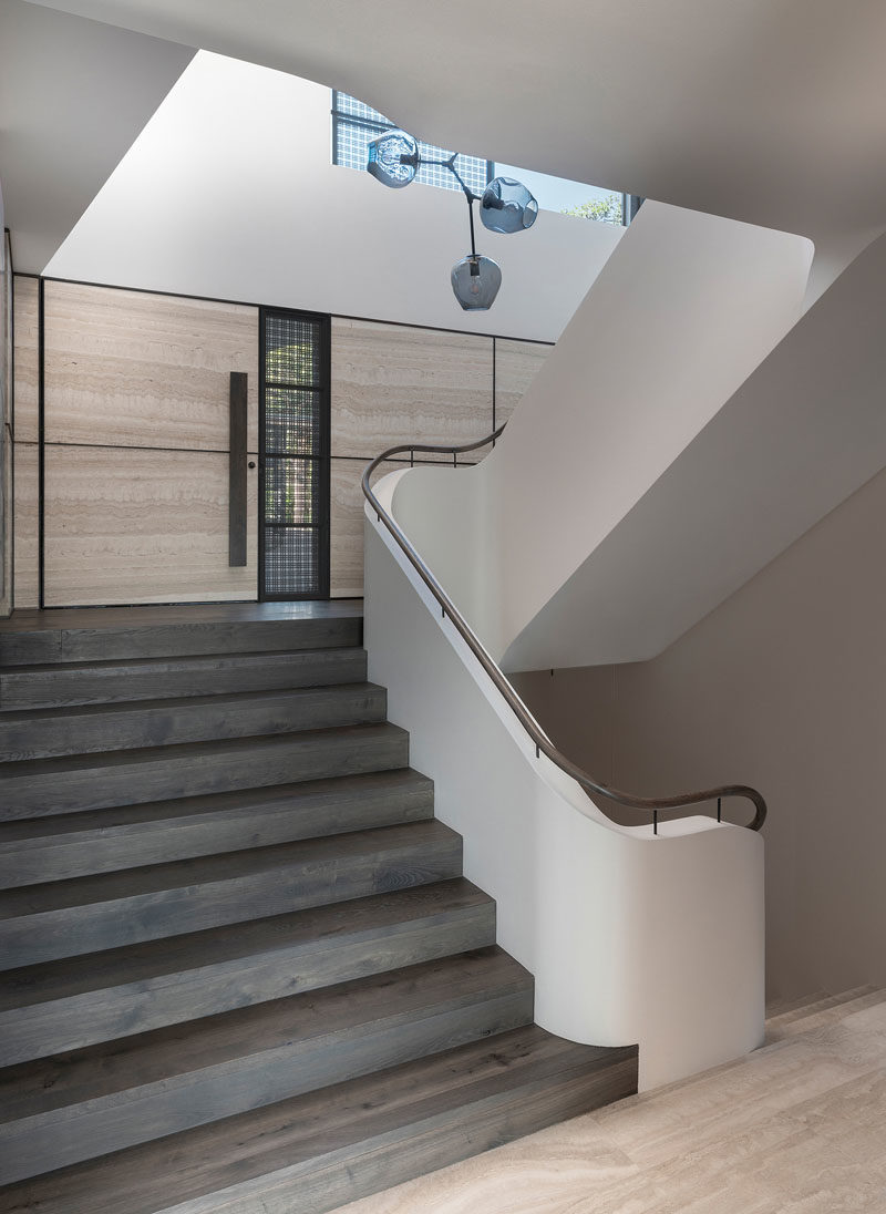Stair Ideas - This modern staircase features a Lindsey Adelman branching bubble chandelier. #StairIdeas #Staircase #InteriorDesign