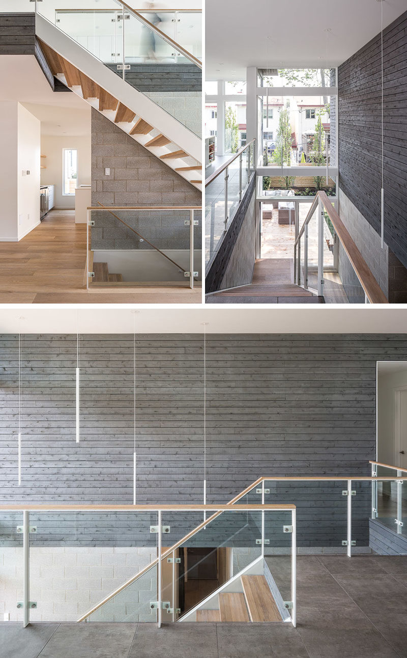 Stair Ideas - This modern open-riser stair rises up through a large double-height space, while honed concrete-block walls and grey-stained cedar siding are showcased on the walls. #StairIdeas #Stairs #Staircase #ModernStairs #CedarSiding #WoodAccentWall