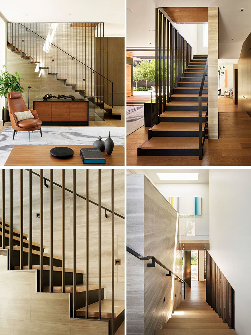 A three-story staircase connects the various levels of this modern house, and showcases a muted material palette, consisting of soft tan Haisa marble, European white oak, and blackened steel. #ModernStairs #Staircase #SteelStairs