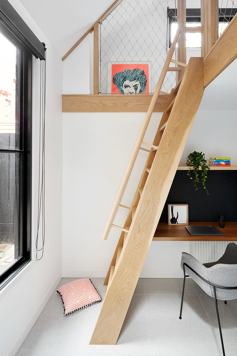 A new wood addition houses a space for studying, as well as a loft, that's been designed as a kids sleepover area. #HouseAddition #StudyArea #KidsPlayLoft