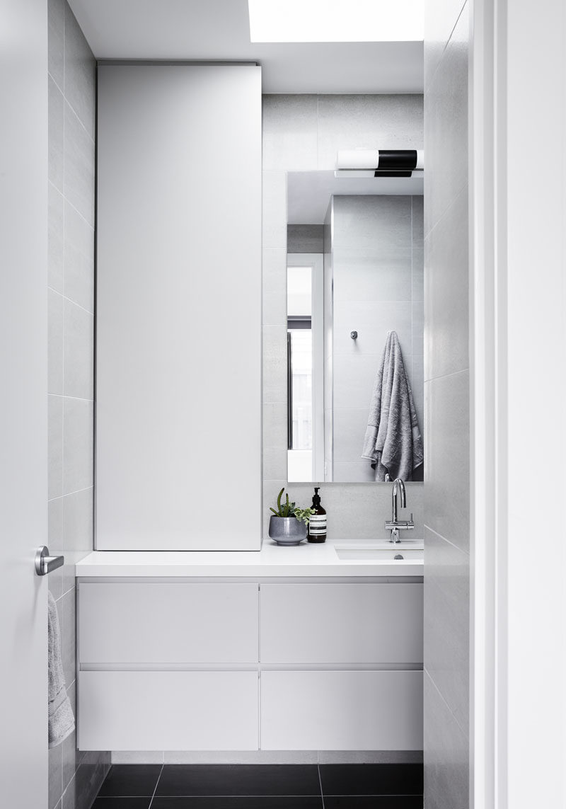 In this small bathroom, the design has been kept minimal, while a skylight draws the eye upwards to the natural light, making the room feel larger and brighter. #Skylight #SmallBathroom #BathroomDesign