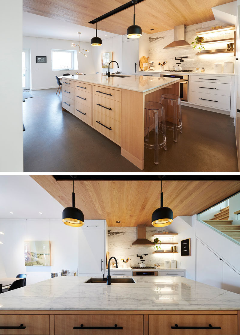 Kitchen Design Ideas - This modern kitchen is defined by the use of a wood ceiling. A large kitchen island provides more counter space, additional storage, and a place for a couple of stools. #KitchenDesignIdeas #WoodCeiling #ModernKitchen #KitchenIsland