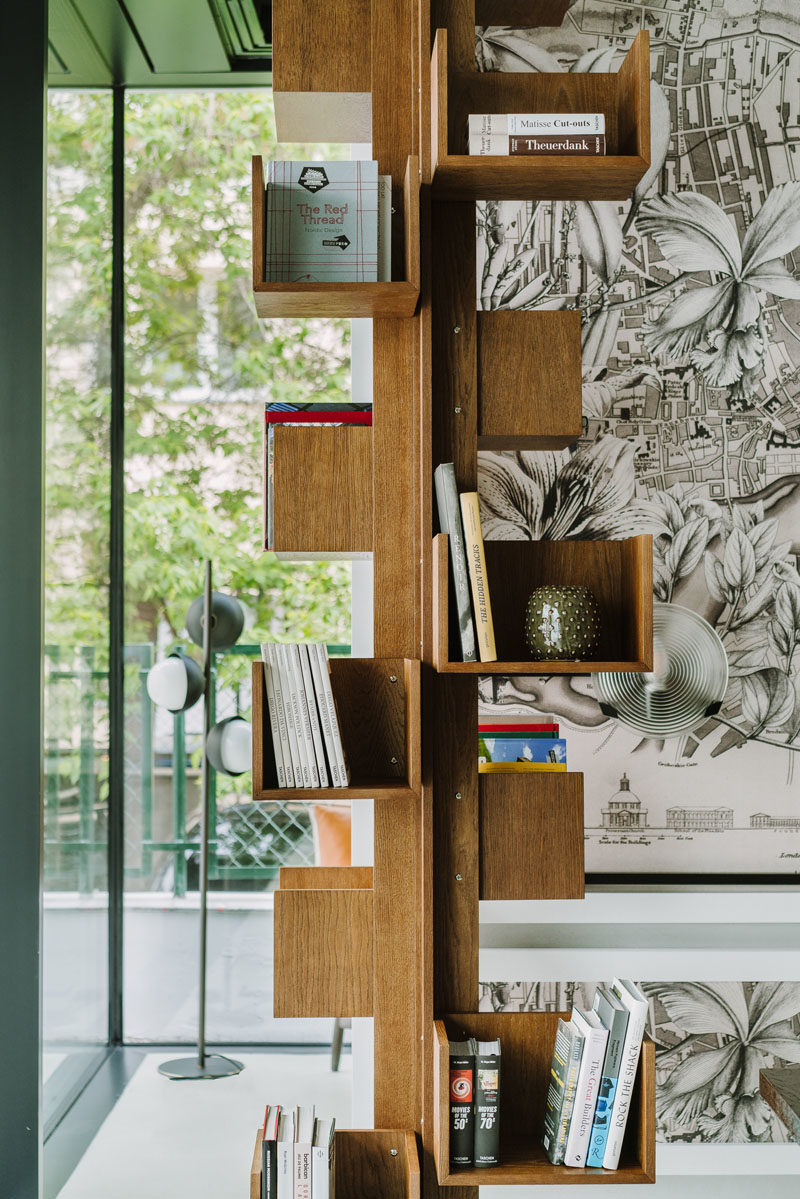 Bookshelf Ideas - This vertical wood bookshelf has small shelves that are mounted on a central column, allowing all four sides to have book storage. #BookshelfIdeas #WoodBookshelf #ColumnBookshelf