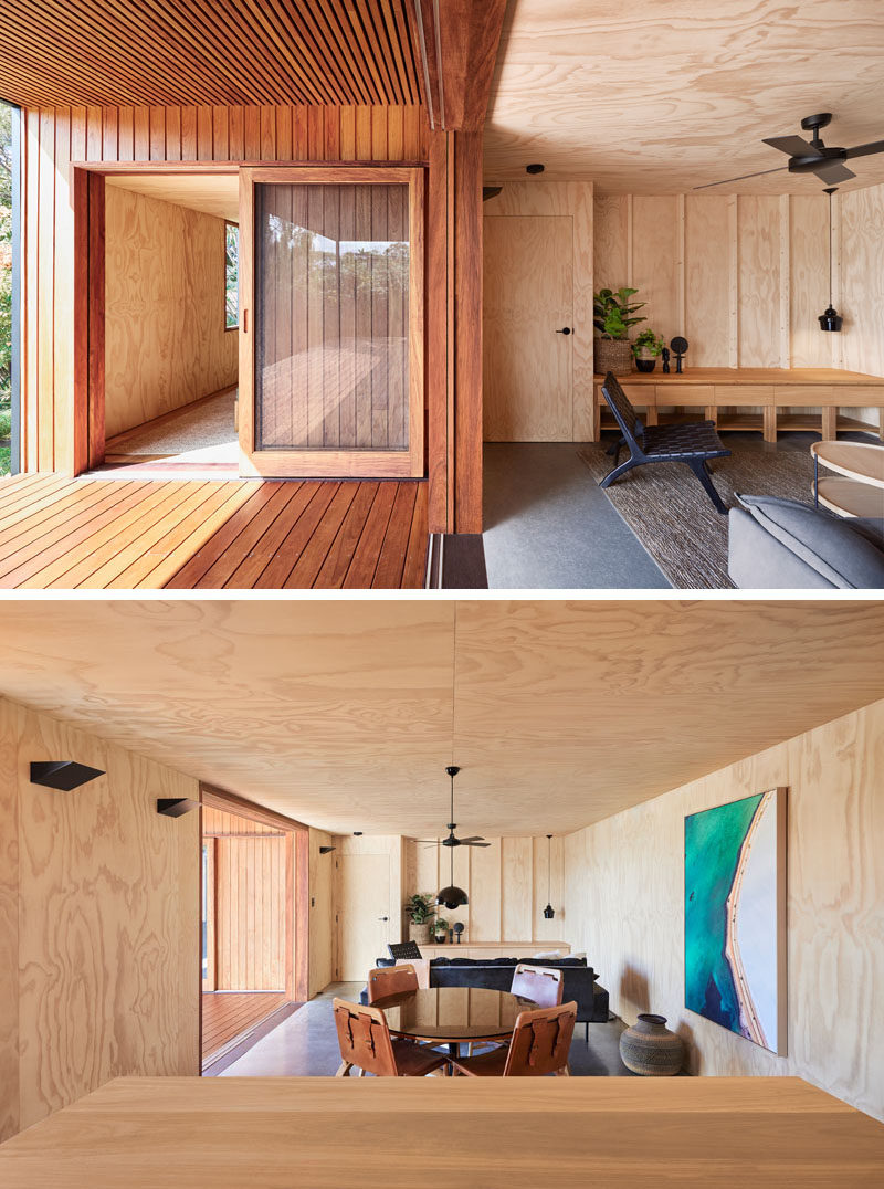 Lined in a warm timber cladding, the porch of this small modern house, provides a gentle contrast to the black exterior. Sliding glass doors connect the outdoor living spaces with the lighter plywood interior. #ModernPorch #ModernHouse #PlywoodInterior