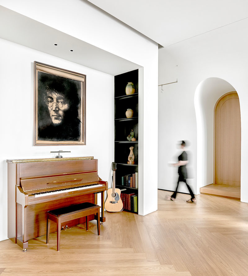 This modern penthouse has small alcoves, like this one, that has been designated as a music area with a piano and guitar stand. #MusicNook #Alcove #InteriorDesign