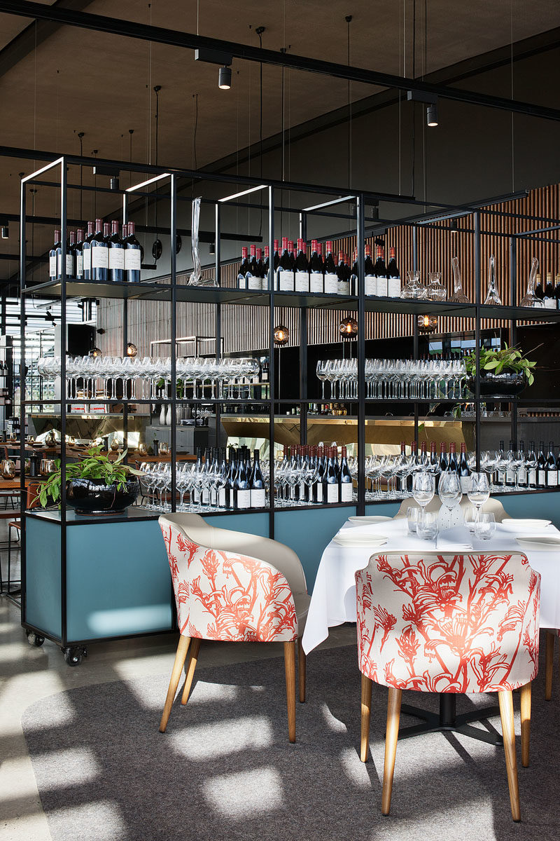 Shelving Ideas - In this modern restaurant, modular shelving on castor wheels enables the space to cater to larger functions. The shelving units also provide display space for merchandise and working zones for waiters. #ShelvingIdeas #RestaurantIdeas #ModularShelving #MoveableShelves #Shelving