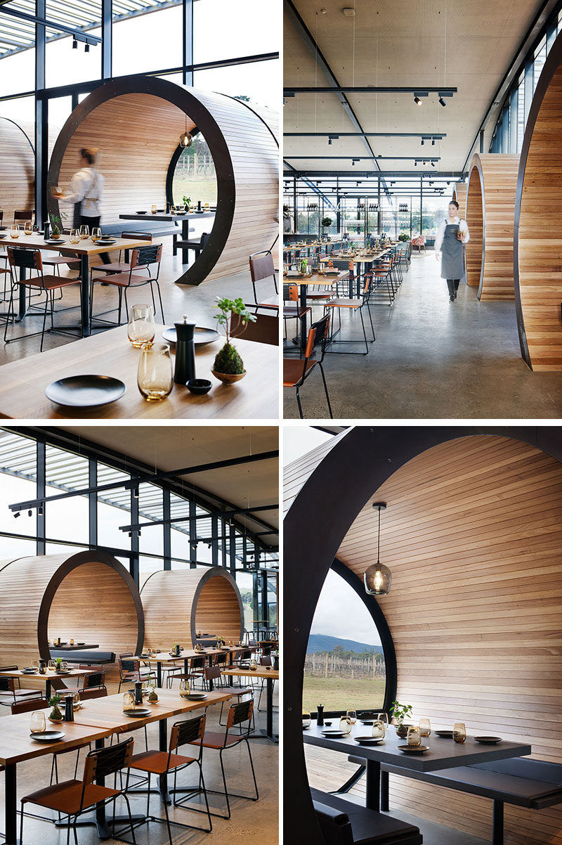 Restaurant Design Ideas - Timber lined barrel booths are positioned along one of the walls of windows in this restaurant, creating a semi-private dining experience, and referencing the wine barrels used within the winery. #RestaurantIdeas #RestaurantDesign #Winery #Seating #Booths