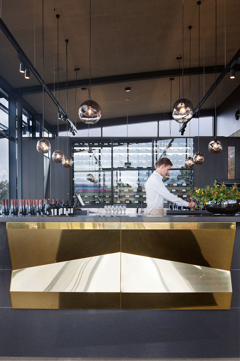 Bar Ideas - These modern winery tasting bars feature a repetitive tectonic form of shifting brass panels to reflect the undulating landscape. #BarIdeas #HospitalityDesign #RestaurantDesign