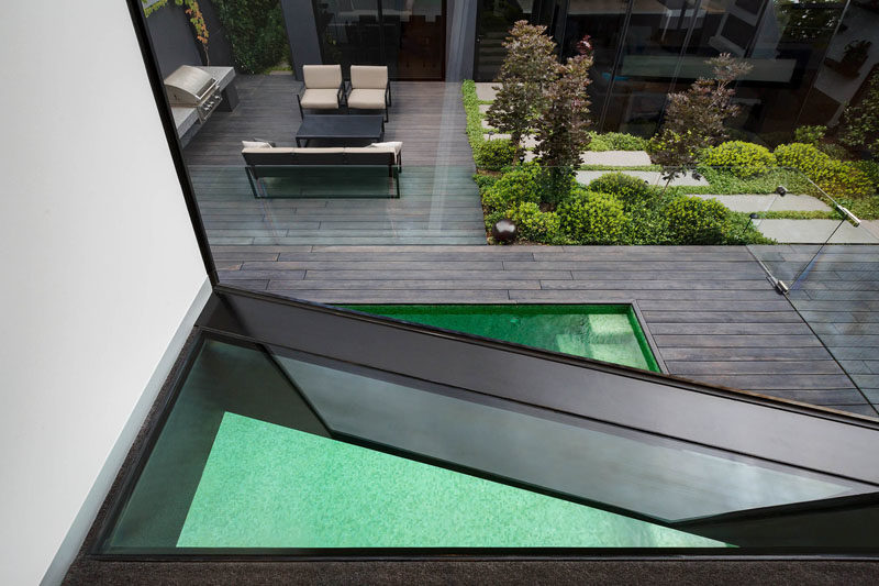 Window Ideas - This first-floor studio has a triangular floor window to provide additional views of the swimming pool. #TriangleWindow #WindowIdeas #FloorWindow