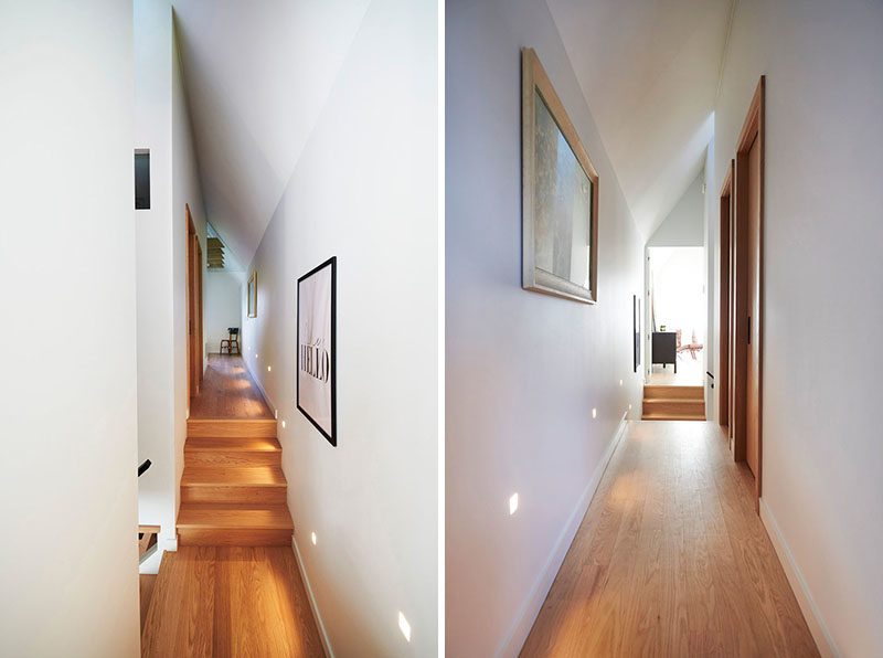 This minimalist hallway has stairs that lead up to the bedrooms on either end. #Hallway #Stairs #InteriorDesign