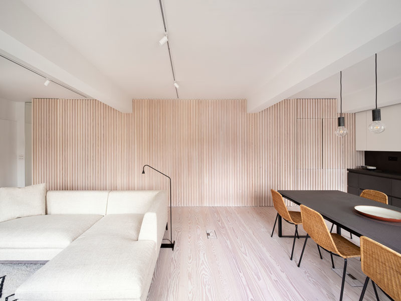 Interior Design Ideas This Wood Batten Wall Provides A Hiding Place For Doors And Appliances
