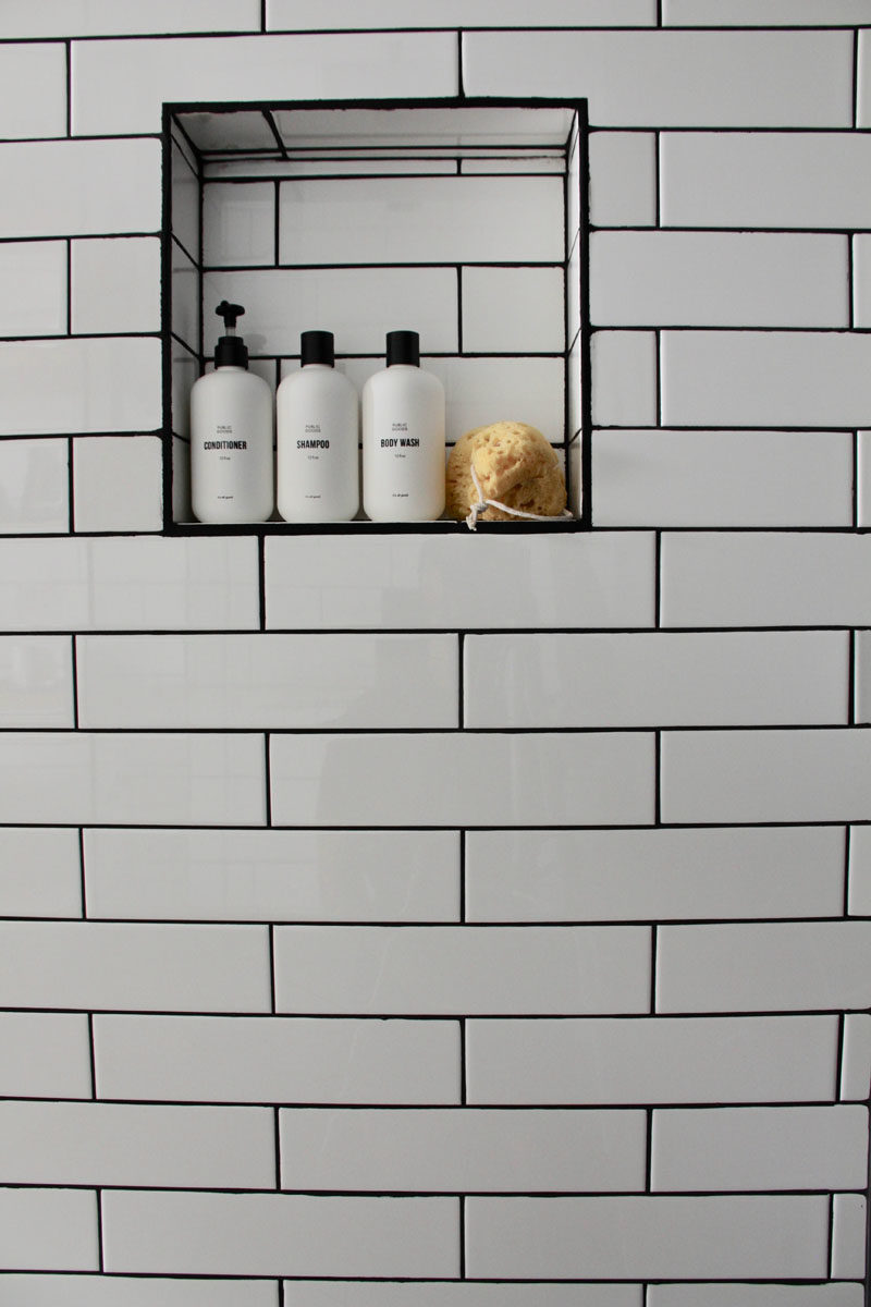 Bathroom Ideas - A built-in shelf in the shower provides a place for storing soap, shampoo, and conditioner. #BathroomIdeas #ShowerShelf #BuiltInShelf #BathroomDesign