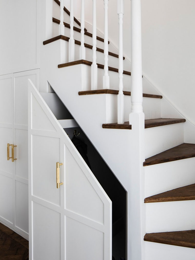 Stair Ideas - The original carpeted stairs were refinished, and the stair treads transformed with wood. Under the stairs, the pull-out cupboards have been extended, providing more storage. #Stairs #StairsWithStorage #StairDesign #StairIdeas