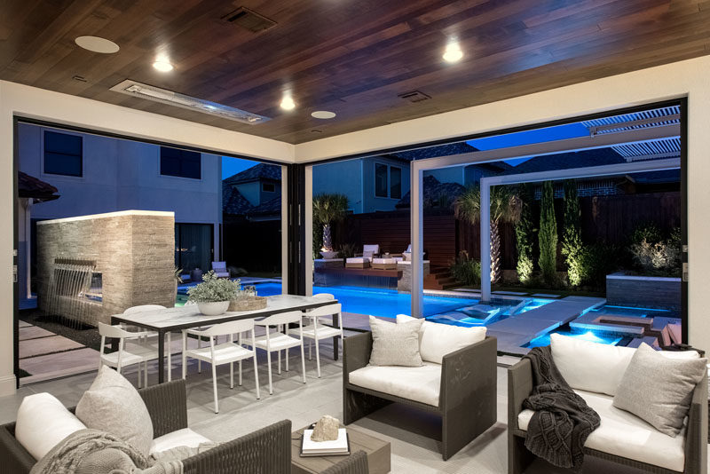 This modern pool cabana features a covered sitting and dining area. #PoolCabana