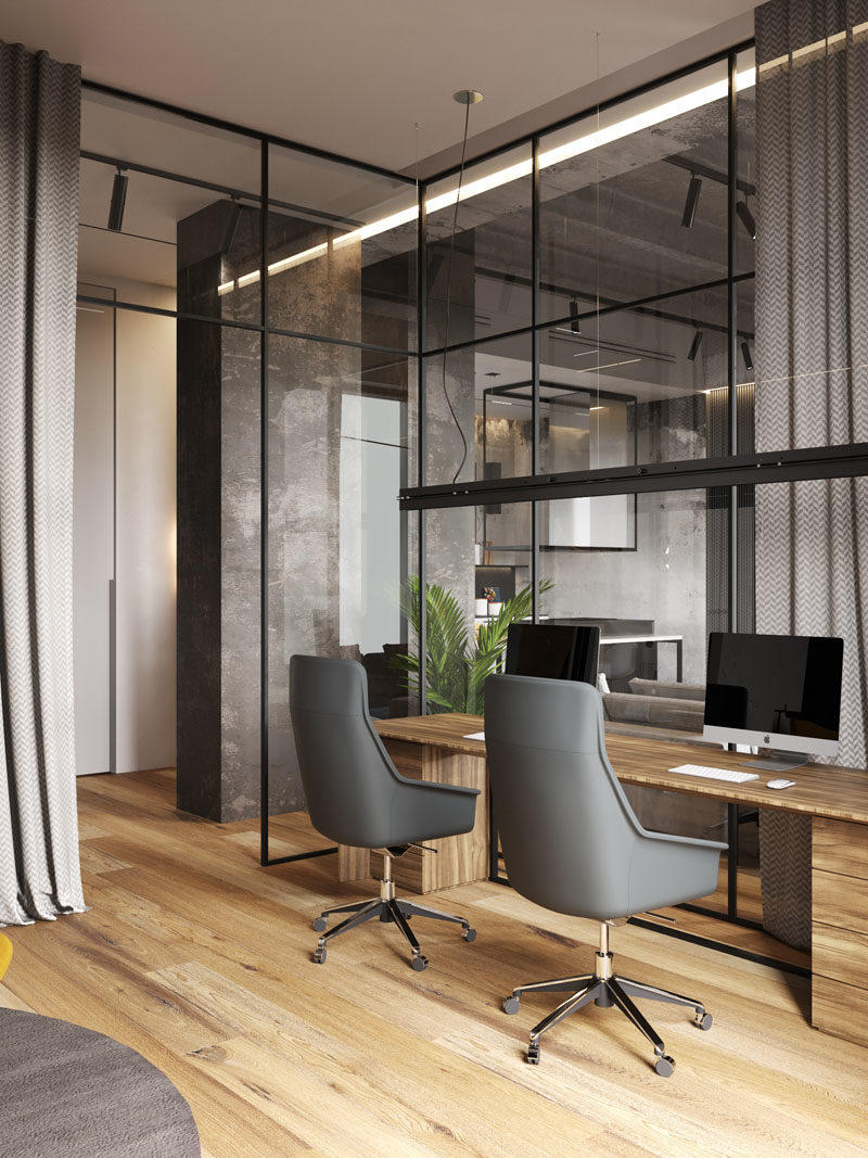 Home Office Ideas - In this modern apartment, and located behind a glass wall, is the home office, that's been designed for two people to share. #HomeOffice #ModernHomeOffice #HomeOfficeIdeas #GlassWall