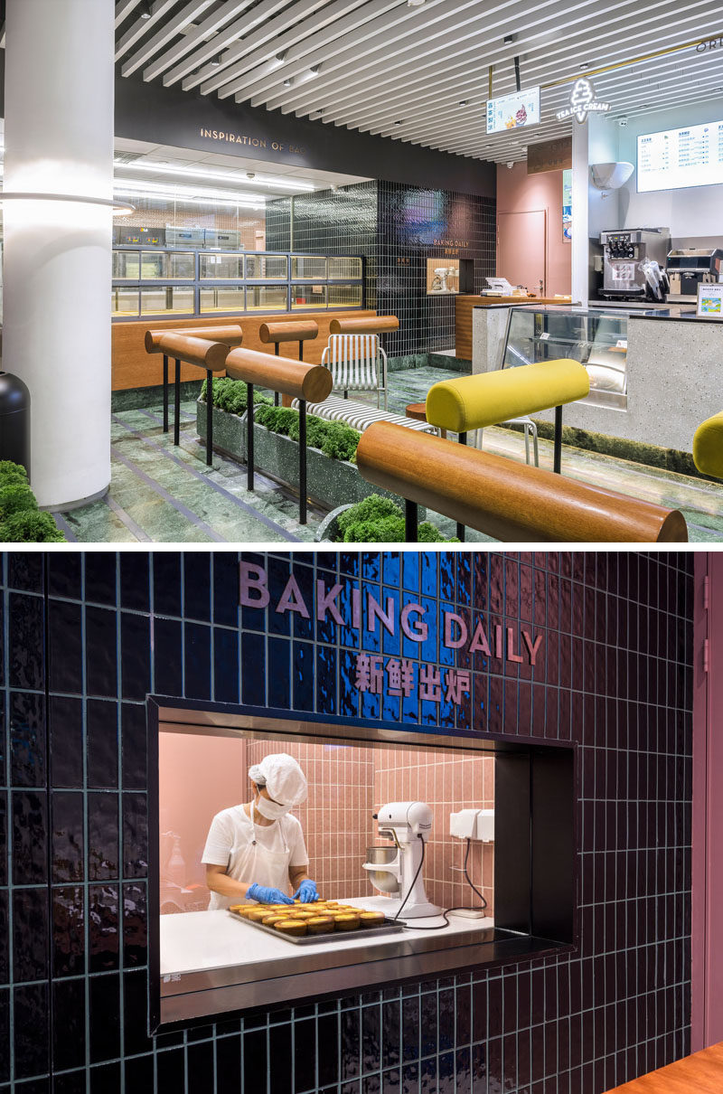 At one end of this modern bakery, there's a black tiled wall that surrounds a window, allowing you to have a glimpse of the bakers at work. #Bakery #BakeryDesign #ModernBaker #Window