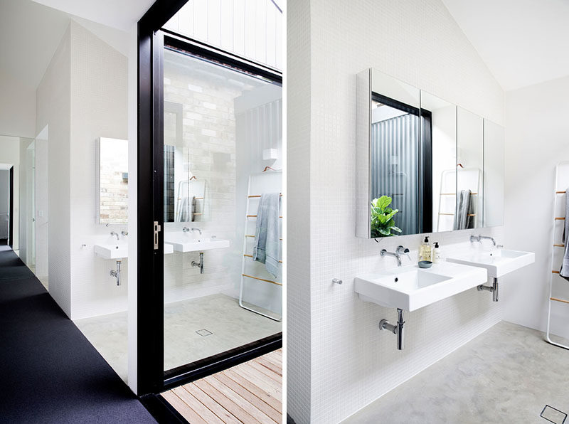 Bathroom Ideas - In this bathroom, dual sinks have been mounted below a mirror that reflects a small internal courtyard. #BathroomIdeas #ModernBathroom