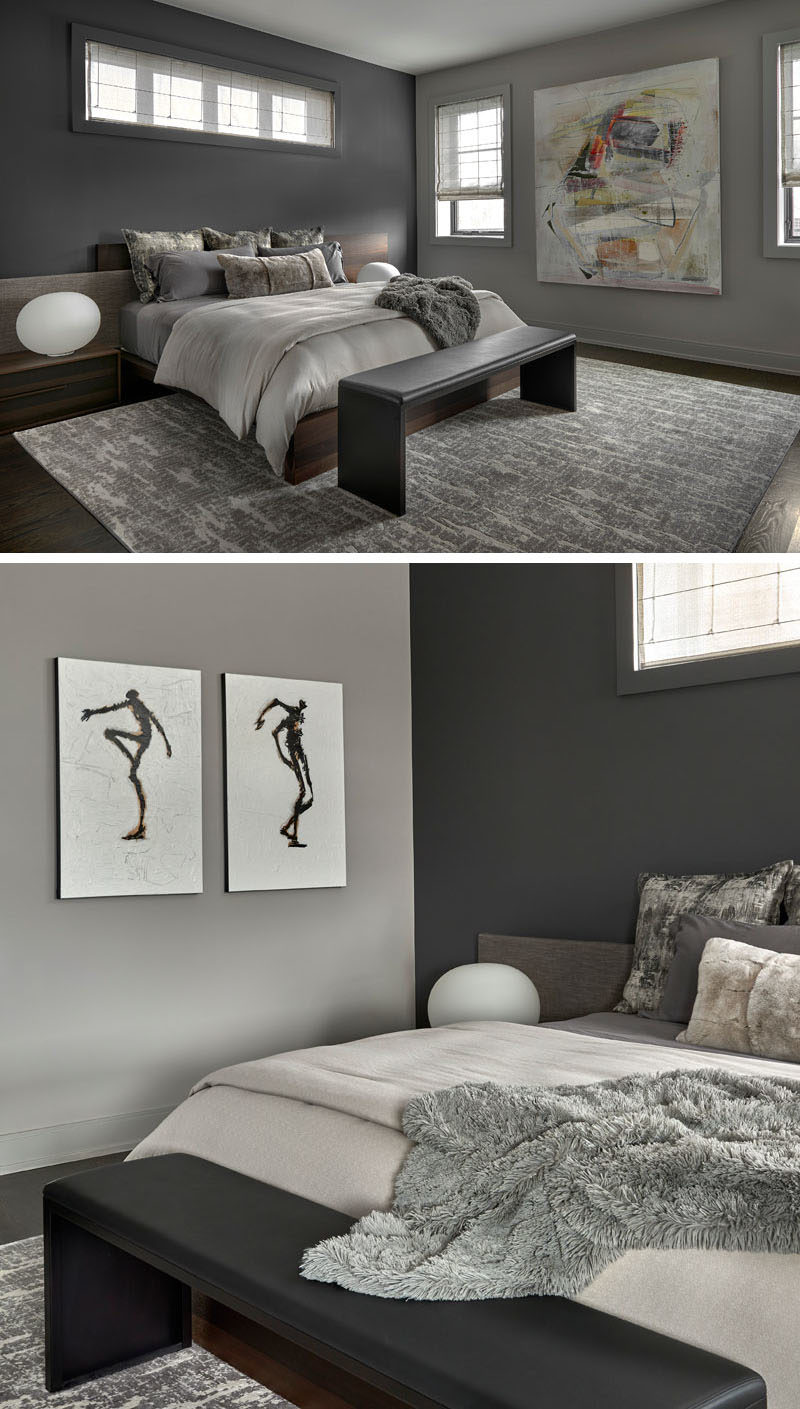 Bedroom Ideas - This modern master bedroom features a wood bed frame with an asymmetrical upholstered and walnut headboard, that also has integrated nightstands. A large wool area rug adds warmth to the room, while Roman shades (with hidden blackout roller shades) add a soft touch. #BedroomIdeas #ModernBedroom #BedroomDesign