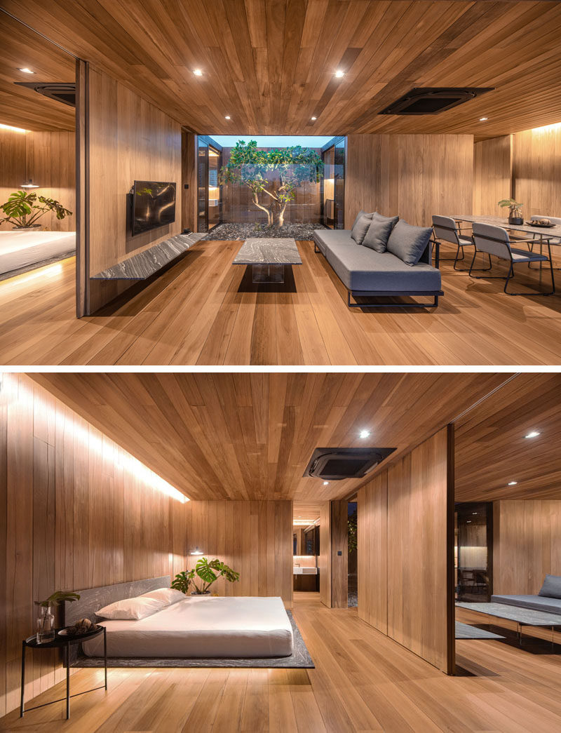 Bedroom Ideas - One of the bedrooms in this modern house is located behind the television wall in the living room, with a pocket door providing access. In the bedroom, hidden lighting creates a soft glow and relaxing atmosphere. #BedroomIdeas #WoodInterior #ModernInterior #ModernBedroom