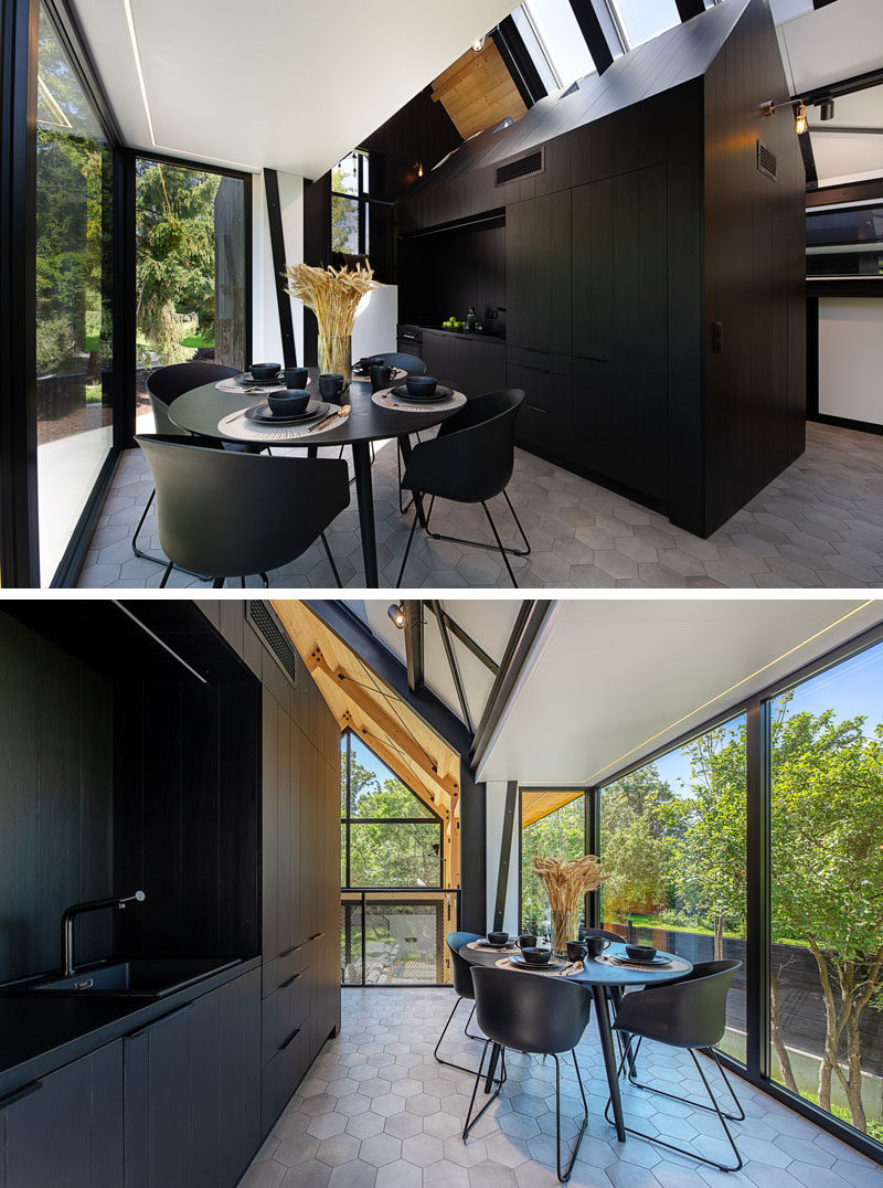 Dining Room Ideas - This small open-plan dining area, that's furnished with black table and chairs, complements the adjacent black kitchen. #DiningRoomIdeas #BlackKitchen