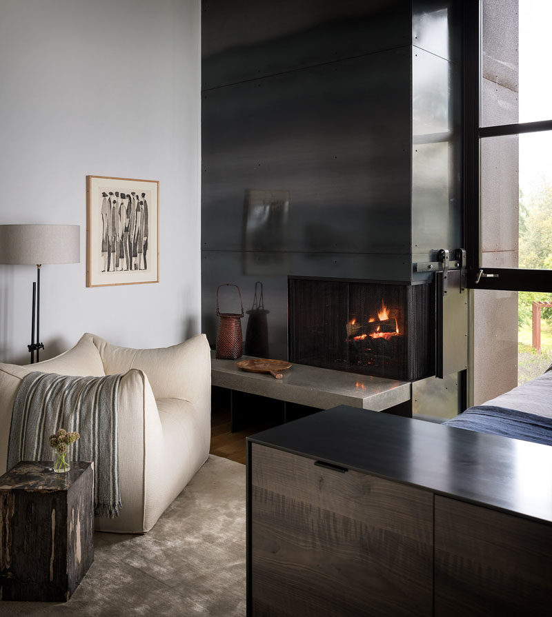 Bedroom Ideas - In this modern master bedroom, a custom leather and steel bed, designed by Geremia in collaboration with fabricator Tod Von Mertens, is complemented by a rolled steel and Thassos marble fireplace. #MasterBedroom #BedroomIdeas #Fireplace #SteelFireplace