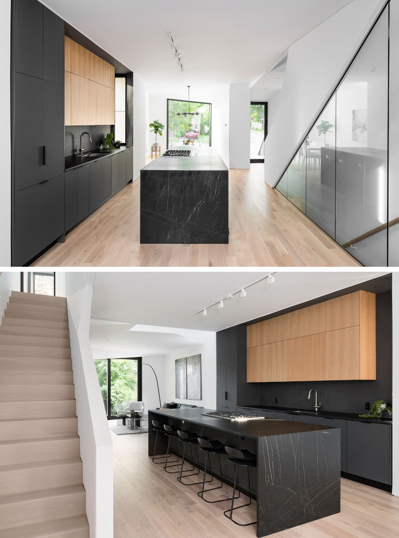 Kitchen Ideas - Inside this modern house, the matte black kitchen cabinets and island draw the attention in the mostly white interior. #BlackKitchen #KitchenIdeas #ModernKitchen #BlackKitchenIsland