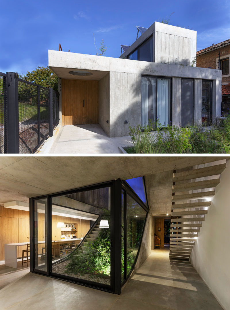 This modern concrete house has been designed to have a garden which connects all of the architectural floors, which is immediately visible from the front door. #ConcreteHouse #ModernHouse #Garden #Landscaping