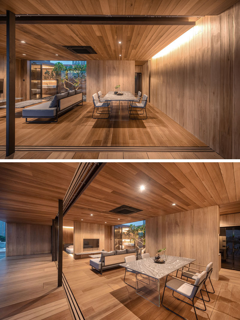 Living Room Ideas - This modern wood house, which also features plenty of glass walls, has an open living room and dining room. #LivingRoom #ModernWood #WoodInterior #HiddenLighting