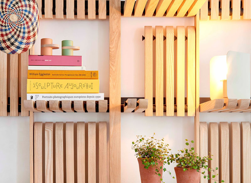 Shelving Ideas - These modern wood wall shelves are made of solid ash blades and can be operated with a single touch, with a system of magnets allowing them to stay in a vertical position. #ShelvingIdeas #WallShelf #FurnitureDesign #Design#Shelf