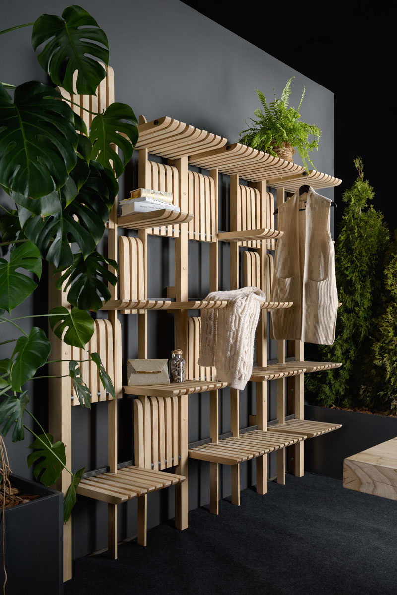 Shelving Ideas - These modern wood wall shelves are made of solid ash blades and can be operated with a single touch, with a system of magnets allowing them to stay in a vertical position. #ShelvingIdeas #WallShelf #FurnitureDesign #Design#Shelf #Wardrobe