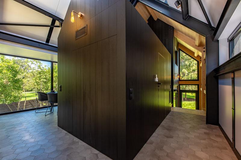 Flooring Ideas - This modern resort house features a hallway with hexagonal floor tiles. #FlooringIdeas #FloorTiles