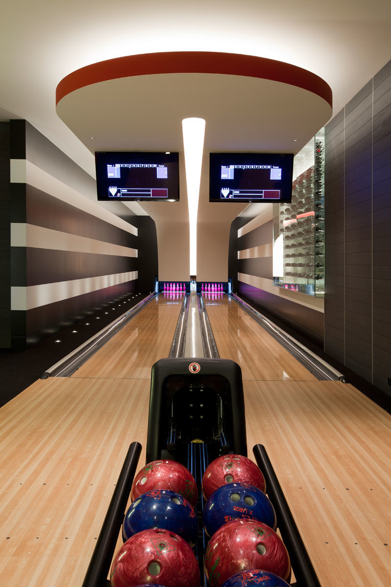 In the basement of this modern house is a two-person bowling alley. #BowlingAlley #Basement