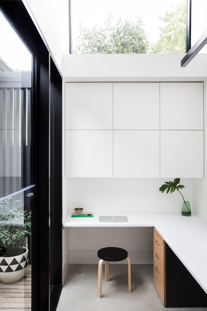 Home Office Ideas - This small home office features a built-in desk and minimalist cabinets. #HomeOffice #InteriorDesign