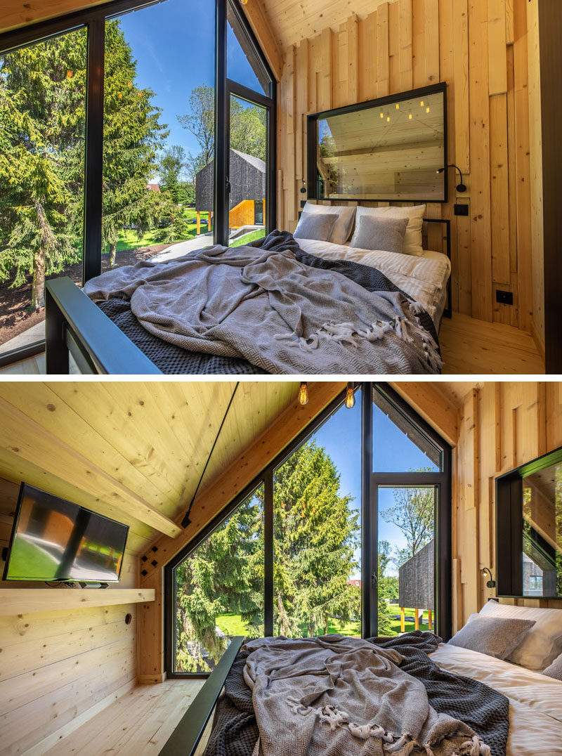 Bedroom Ideas - In this modern bedroom, natural wood elements are highlighted, while large windows follow the roof line. #BedroomIdeas #BedroomDesign #Windows
