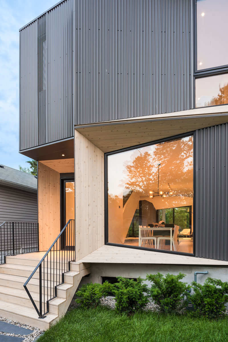 The angled portions of this modern house are highlighted by the use of wood, which directly contrasts the black window frames and the dark steel corrugated siding. #ModernArchitecture #HouseDesign #Windows #ModernHouse