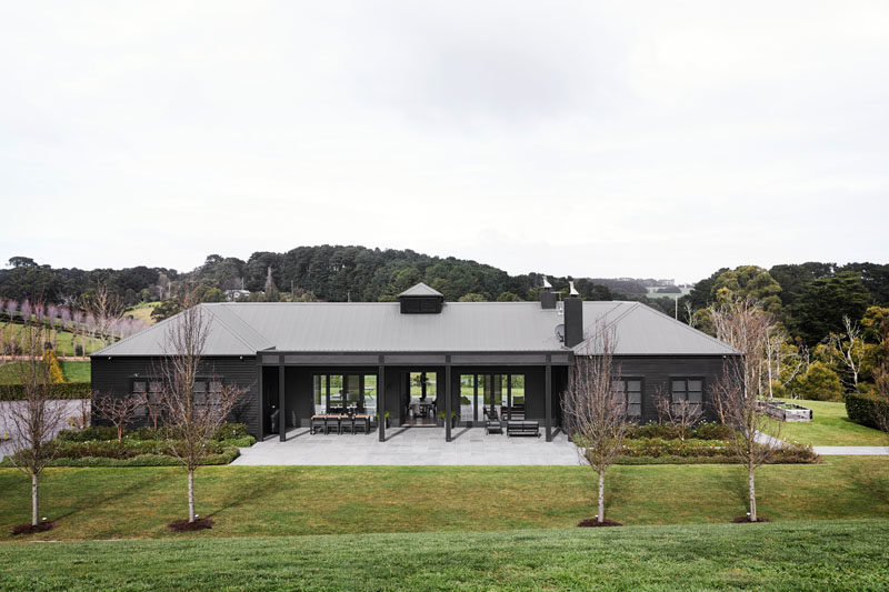 Located on a quiet hillside in the idyllic Victorian town of Main Ridge, this modern farmhouse is casual, sophisticated and livable, merging the form of a traditional farmhouse with clean contemporary lines. #ModernFarmhouse #ModernHouse #ModernArchitecture