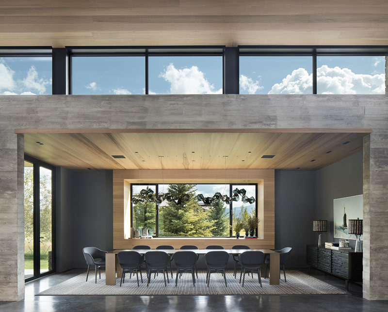 Dining Room Ideas - This large and open modern dining room has a table big enough to seat twelve. #DiningRoomIdeas #DiningRoom #LargeDiningTable