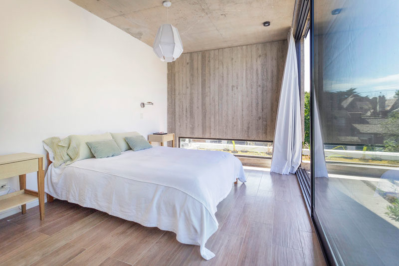 Bedroom Ideas- This modern master bedroom is filled with natural light from the large sliding glass door that opens to the rooftop. #MasterBedroom #BedroomDesign #BedroomIdeas
