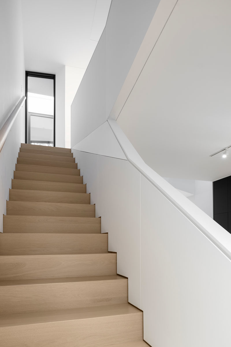 Stair Ideas - This modern house has light wood stairs leading to the upper floor of the home. #ModernWoodStairs #StairIdeas #StairDesign