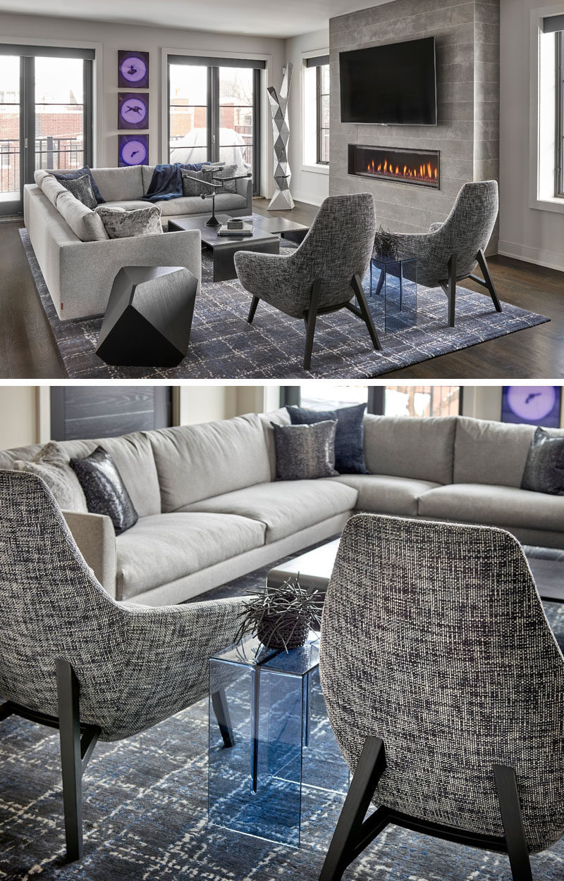Living Room Ideas - In this modern living room, a comfortable sectional couch is focused on the fireplace, and anchored in the room by a large grey and white rug. #LivingRoom #ModernLivingRoom #Fireplace