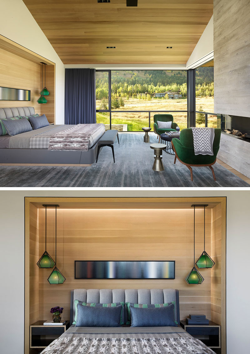 Bedroom Ideas - In this modern master bedroom, the bed has been built into a small alcove with hidden lighting, while floor-to-ceiling windows frame the views. #MasterBedroom #BedroomIdeas #Modernbedroom #Fireplace #Windows