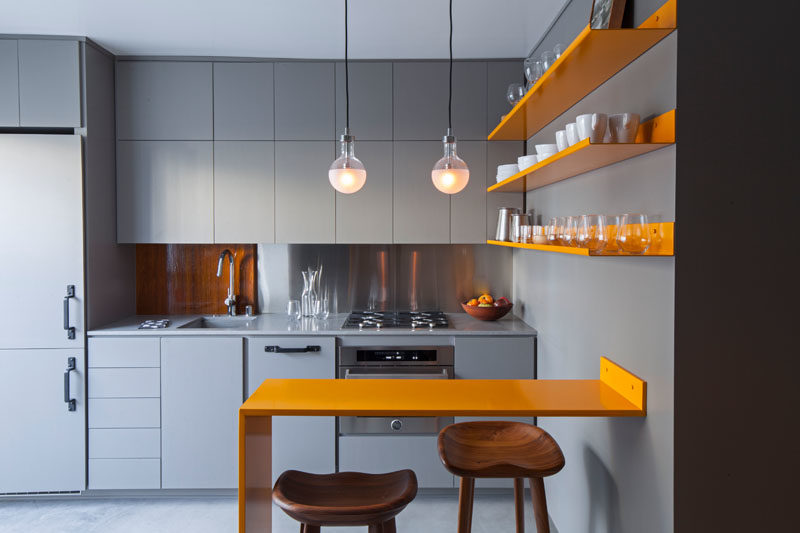 A Micro Apartment With A Grey And Yellow Color Palette