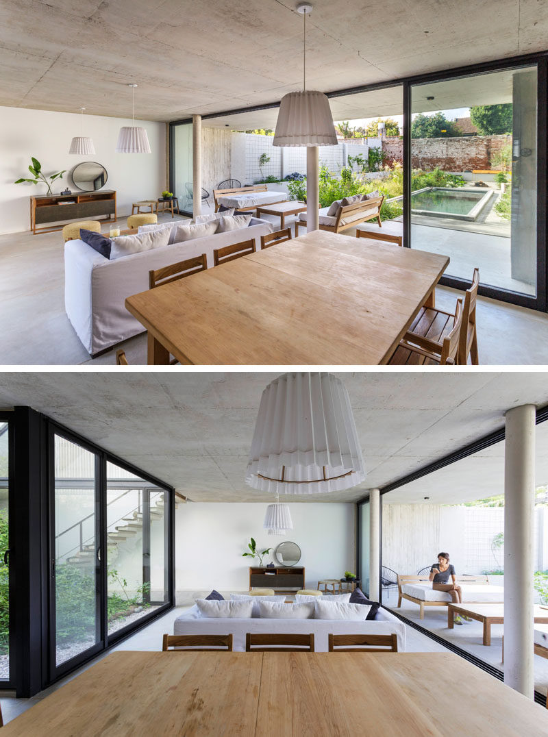 The main social areas of this modern house are open plan, with the living room and dining room sharing the space, while large sliding doors open to the patio and yard, creating an indoor / outdoor living environment. #ModernInterior #OpenPlan #SlidingGlassDoors