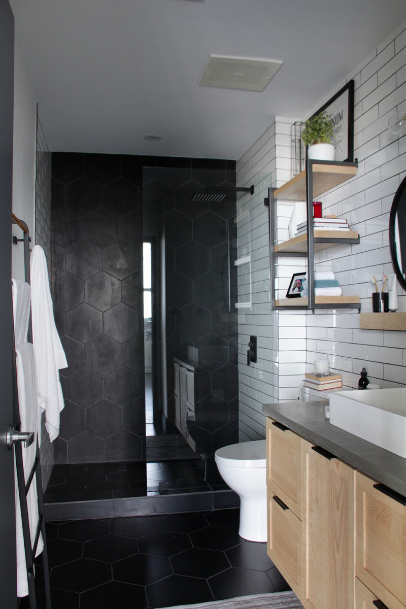 Bathroom Ideas - Matte black large format hexagonal tiles were used in the new walk-in shower and on the floor. #HexagonalTiles #ModernBathroom #BathroomIdeas #BlackTiles