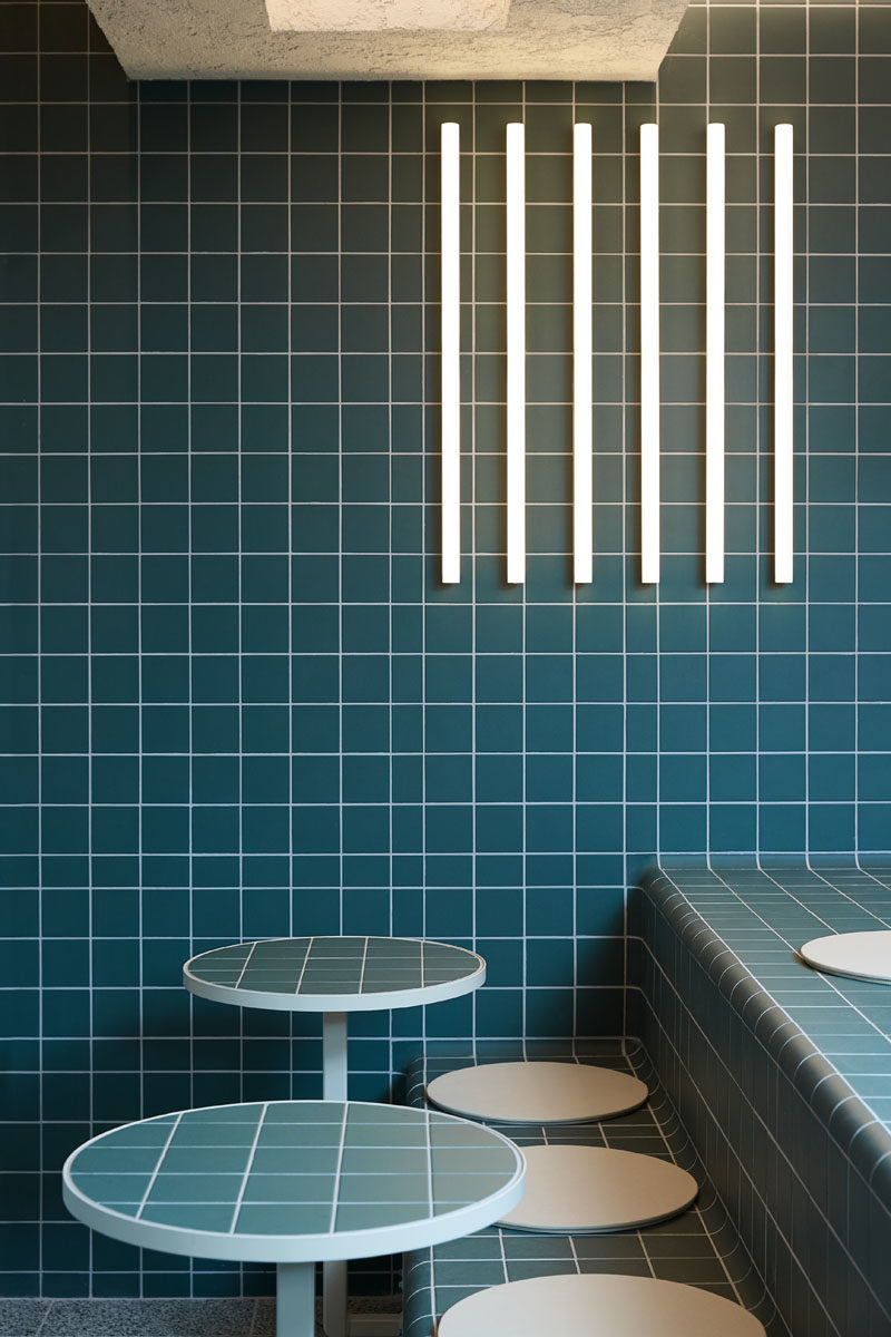 Restaurant Ideas - Deep blue-green tiles have been used throughout this modern restaurant to create a unified appearance that's inspired by retro 60's style and Korean bath houses. #Tile #RestaurantDesign #RestauarantIdeas