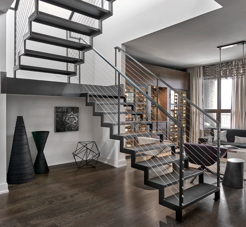 Stair Ideas - This industrial modern blackened steel staircase leads to the roof deck of this modern penthouse apartment. #SteelStairs #StairIdeas