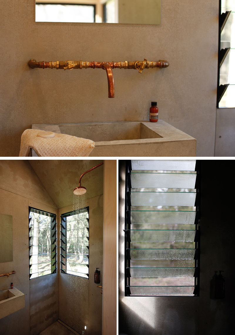 This tiny house has a bathroom that features a concrete basin and copper faucet adds an industrial modern look to the bathroom, while louvre windows in the shower help the air circulate. #TinyHouse #Tinyhome #Bathroom #ConcreteVanity #LouverWindows