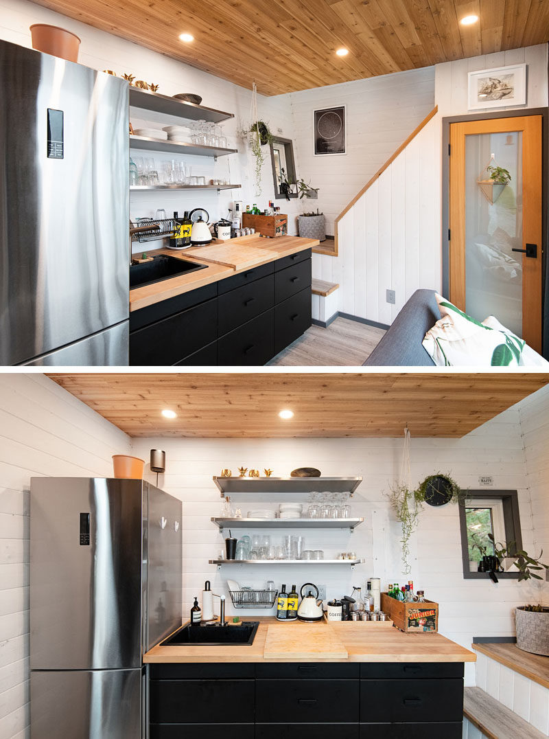 Tiny House Ideas - Inside this tiny house (cabin), white walls help to keep the lower floor bright, while the living room and kitchen share the space, and a bathroom is located under the stairs. #TinyHouseIdeas #TinyCabin #TinyHouse #KitchenDesign