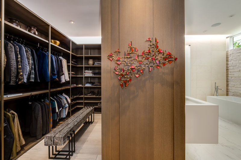Closet Ideas - Between the master bedroom and the bathroom is a custom designed walk-in closet with plenty of storage. #WalkInCloset #ClosetIdeas #WalkInWardrobe